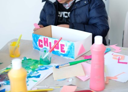 A table covered in paint and craft materials