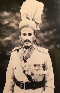 A Punjabi man in uniform with an ornate turban and long row of medals on his chest