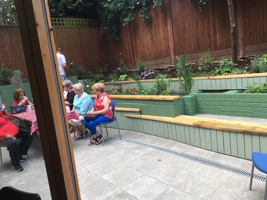 People sitting in a patio garden